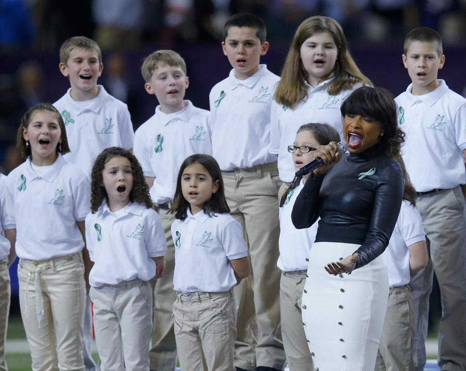 "Jennifer Hudson singing ""America the Beautiful"" with the Sandy Hook Elementary School choir before the Super Bowl."
