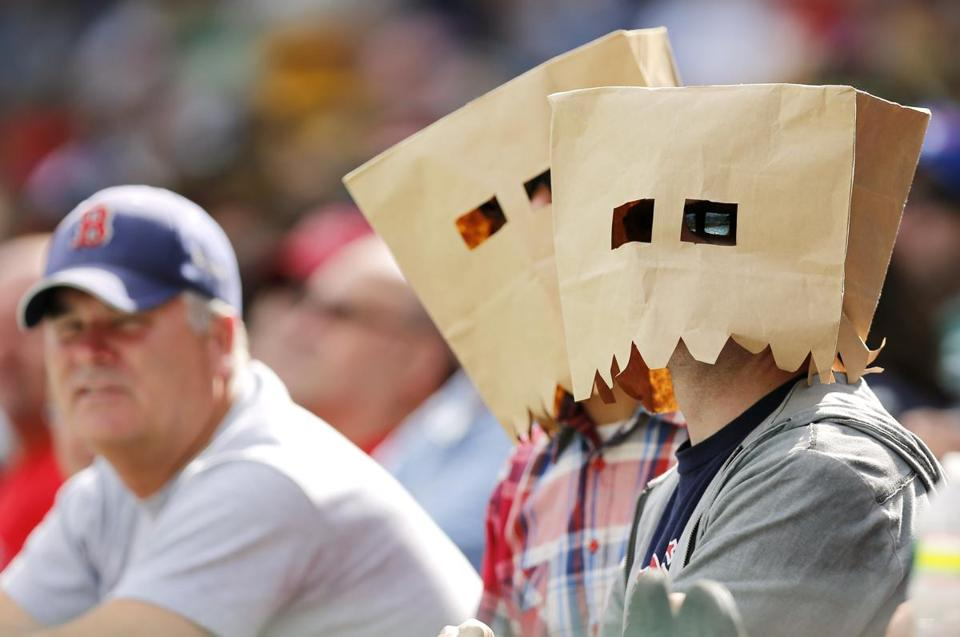 Boston fans wear paper bags on their heads during a game against Toronto at Fenway Park Sept. 9. The Blue Jays won 4-3 to sweep the three-game series.