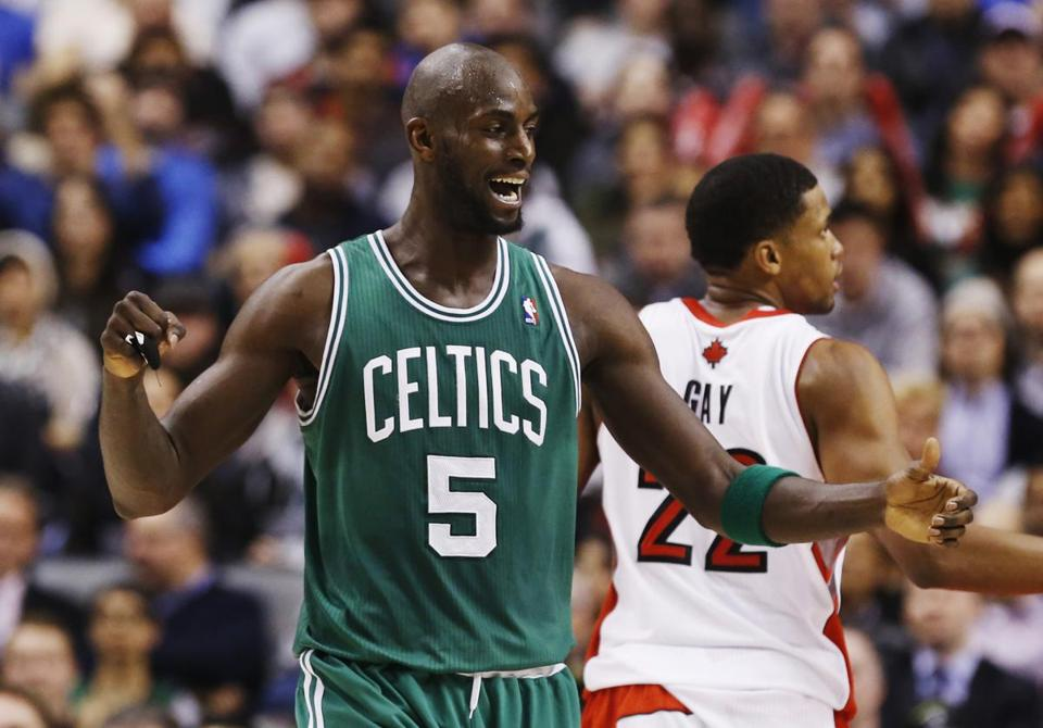 Kevin Garnett (27 points, 10 boards) goes to the hoop against Toronto's Amir Johnson in the second half.