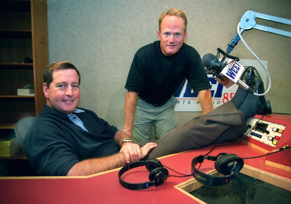 WEEI sports talk show hosts Gerry Callahan (right) and John Dennis. The loss of advertising is seen as a blow to the station.