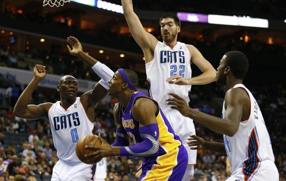Lakers center Dwight Howard was surrounded by Bobcats in the first half. The Lakers overcame a 20-point second-half deficit to win.