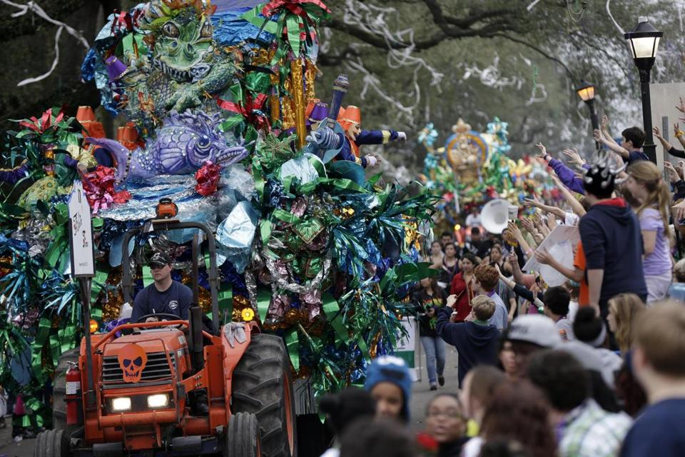 Floats passed down a New Orleans street on Sunday, hours after a shooting on Bourbon Street injured four people.