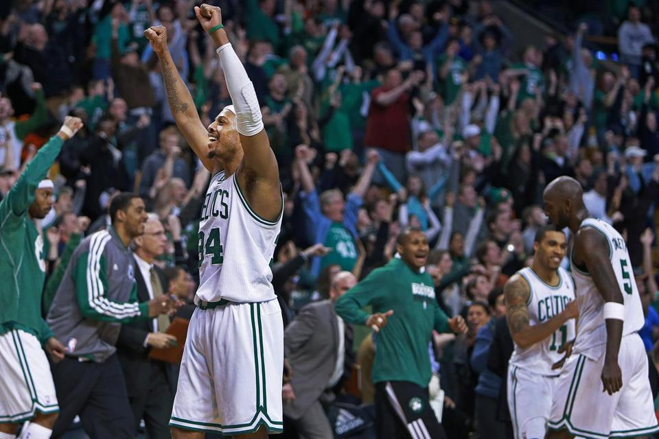 Paul Pierce, who had 27 points, 14 rebounds, and 14 assists, is especially happy as the final horn sounds in Boston's triple-overtime victory.