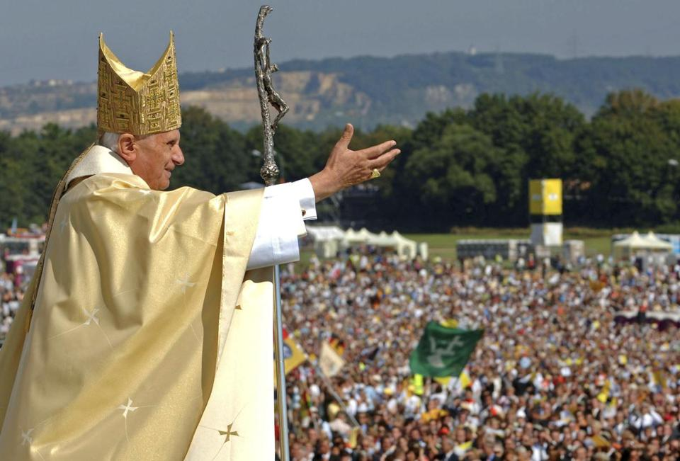 In this Sept. 12, 2006, file photo, Pope Benedict XVI waves to the crowd at the end of a papal Mass in Regensburg, southern Germany.