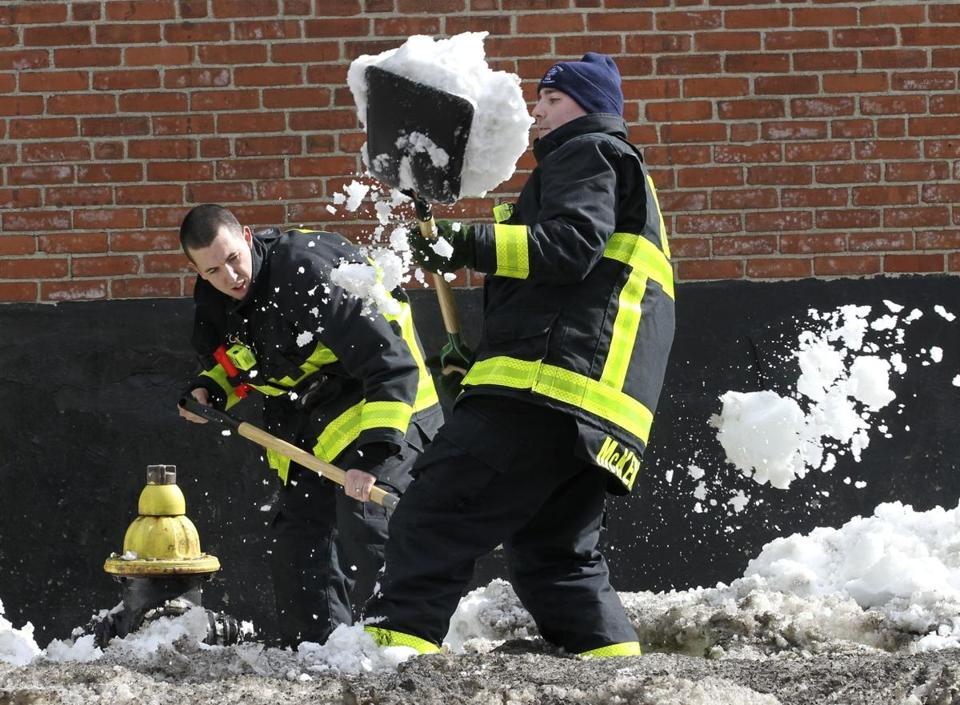 Boston firefighter recruits Tom Nee and Pat McKenna shoveled out a hydrant on Columbus Avenue on Tuesday.
