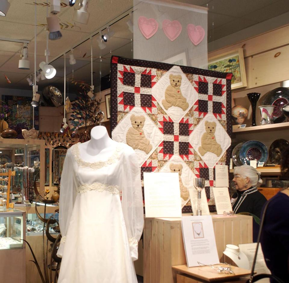 "A wedding gown from 1977 and a teddy bear quilt are part of the ""Expressions of Love"" exhibit, organized by Handworks Gallery owner Glenn Johnson."