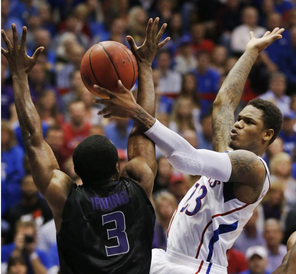 Kansas guard Ben McLemore (right) rebounds against Kansas State guard Martavious Irving (left) during the first half of an NCAA college basketball game in Lawrence, Kan., Monday, Feb. 11, 2013.