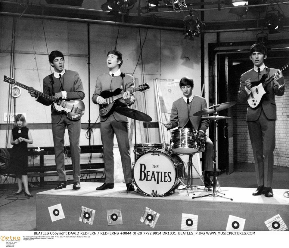The Beatles — (from left) Paul McCartney, John Lennon, Ringo Starr, and George Harrison — performing on British television in 1963.