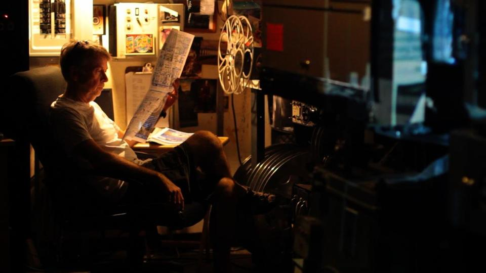 "Dave Leamon, one of the subjects in Peter Flynn's documentary ""The Dying of the Light,"" in the projection booth at the Brattle Theatre in Cambridge."