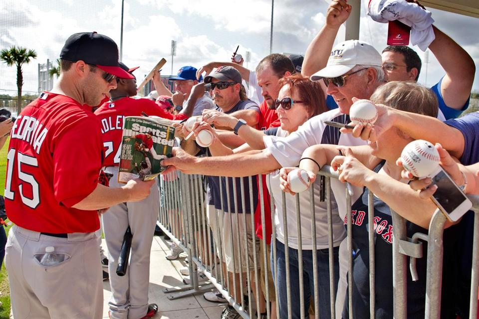 A sure sign of spring is the line for autographs at JetBlue Park in Fort Myers, Fla. Among those doing the honors were Dustin Pedroia and Jackie Bradley.