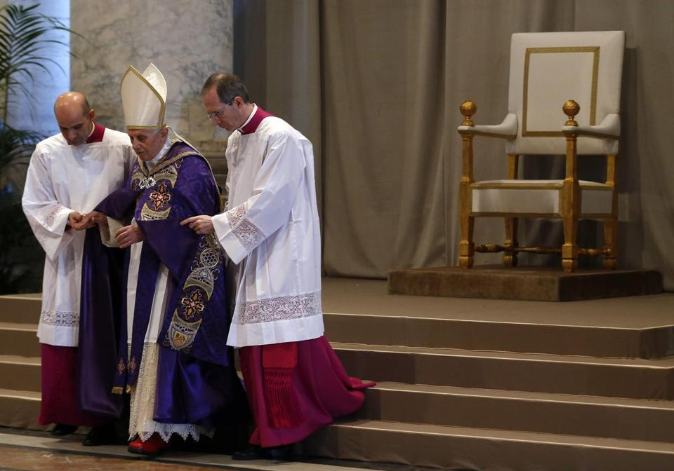 Pope Benedict XVI was aided down the steps of the altar after the Ash Wednesday Mass at St. Peter's Basilica in Rome.