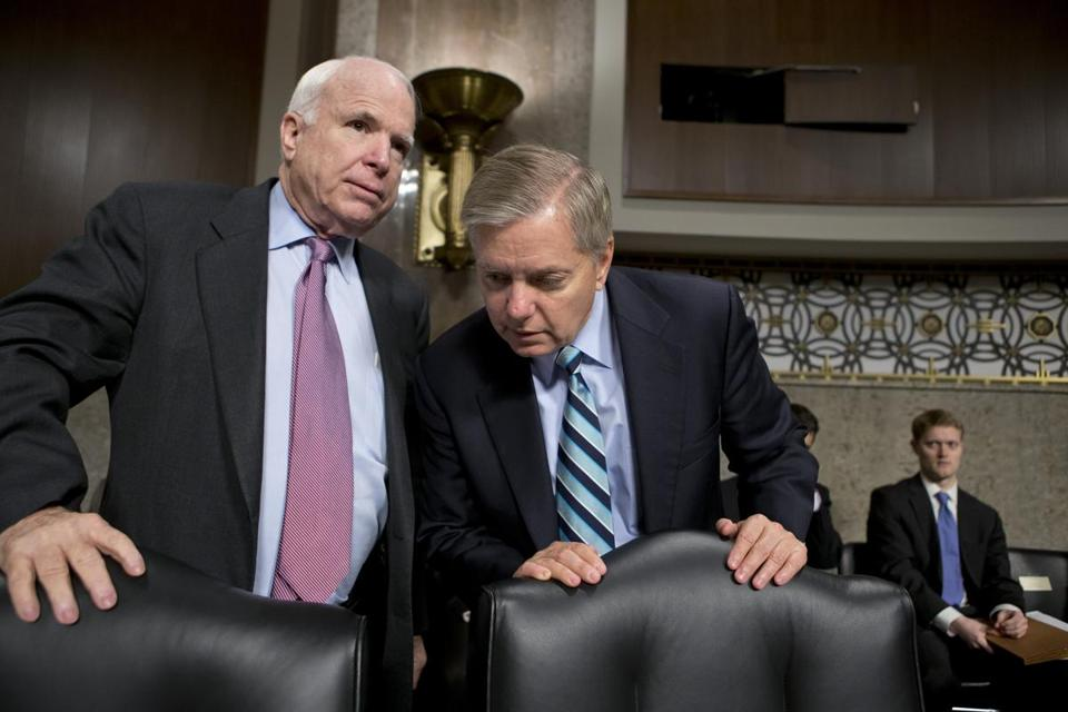 Senators John McCain (left) and Lindsey Graham voted against the nomination despite voicing objections to the use of the filibuster against defense secretary nominees.