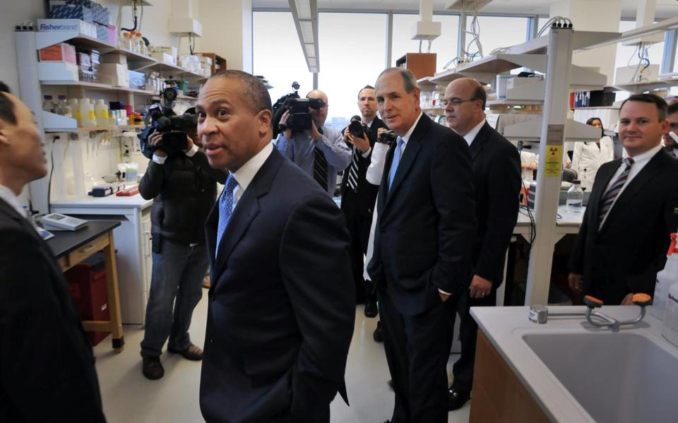UMass Medical School chancellor Michael F. Collins (second left) gave Gov. Deval Patrick, U.S. Rep. James P. McGovern, and Lt. Gov. Timothy P. Murray a tour of the school in January.