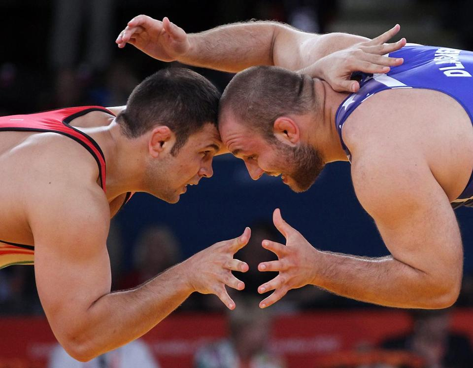 Komeil Ghasemi of Iran faced off with American Tervel Ivaylov Dlagnev at the 2012 Olympics.