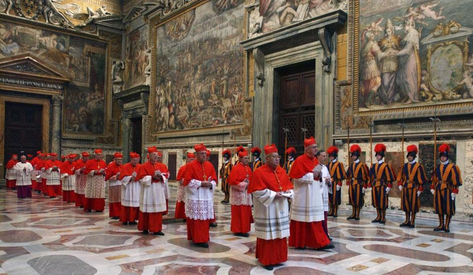 The conclave, like the one in 2005 (pictured) will begin with the cardinals in their red cassocks filing into the Sistine Chapel, chanting.