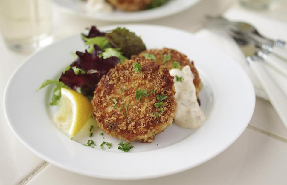 Pan-fried fish cakes with homemade tartar sauce.