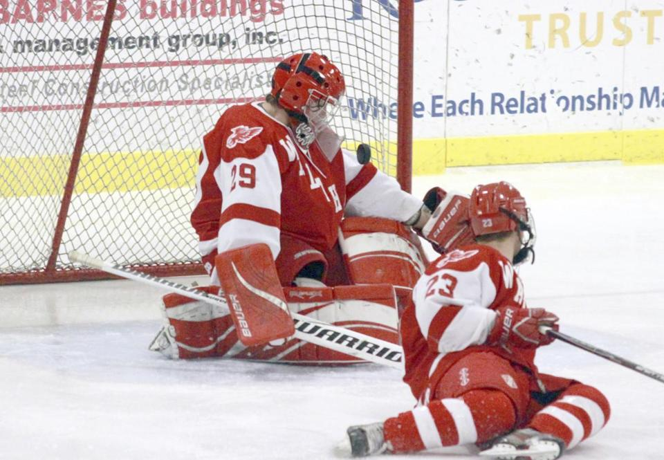 Waltham goalie Nick Russo stops a shot from Archbishop Williams during the first round of the 2013 Cape Cod Classic hockey tournament at Falmouth Ice Arena in East Falmouth.