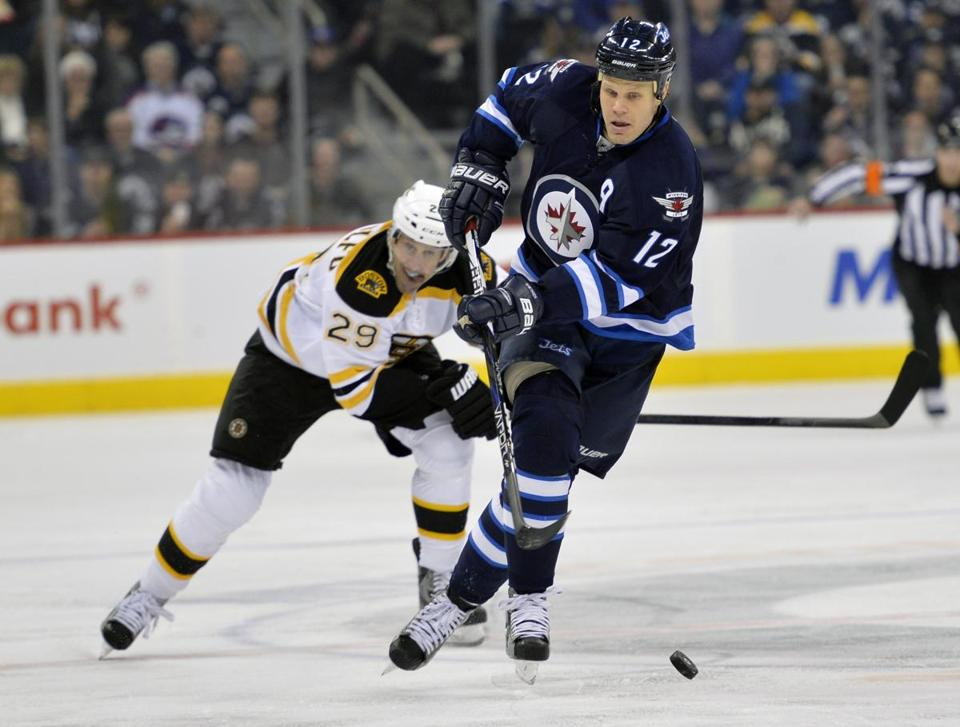 The Bruins' Jay Pandolfo tried to chase down the Jets' Olli Jokinen during the second period.