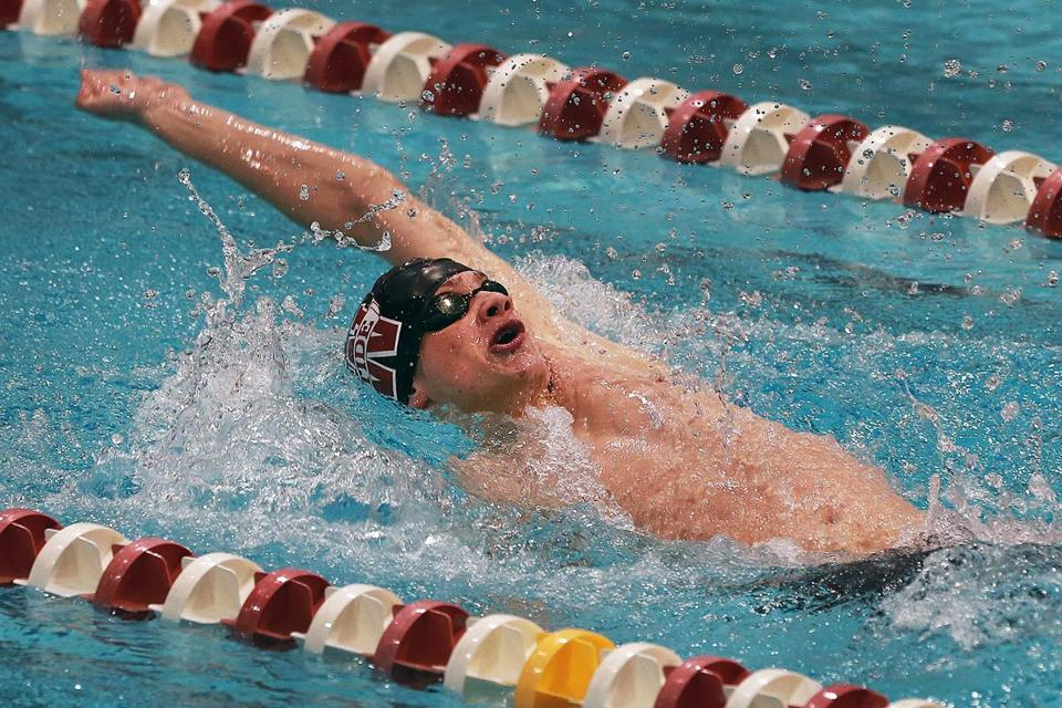 Weston's Jack Blyzinskyj keeps his arms in constant motion in the pool during the 100 backstroke.