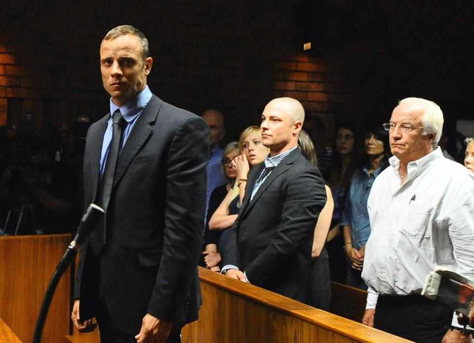 Oscar Pistorius stood in court as he was formally charged with murder on Tuesday.