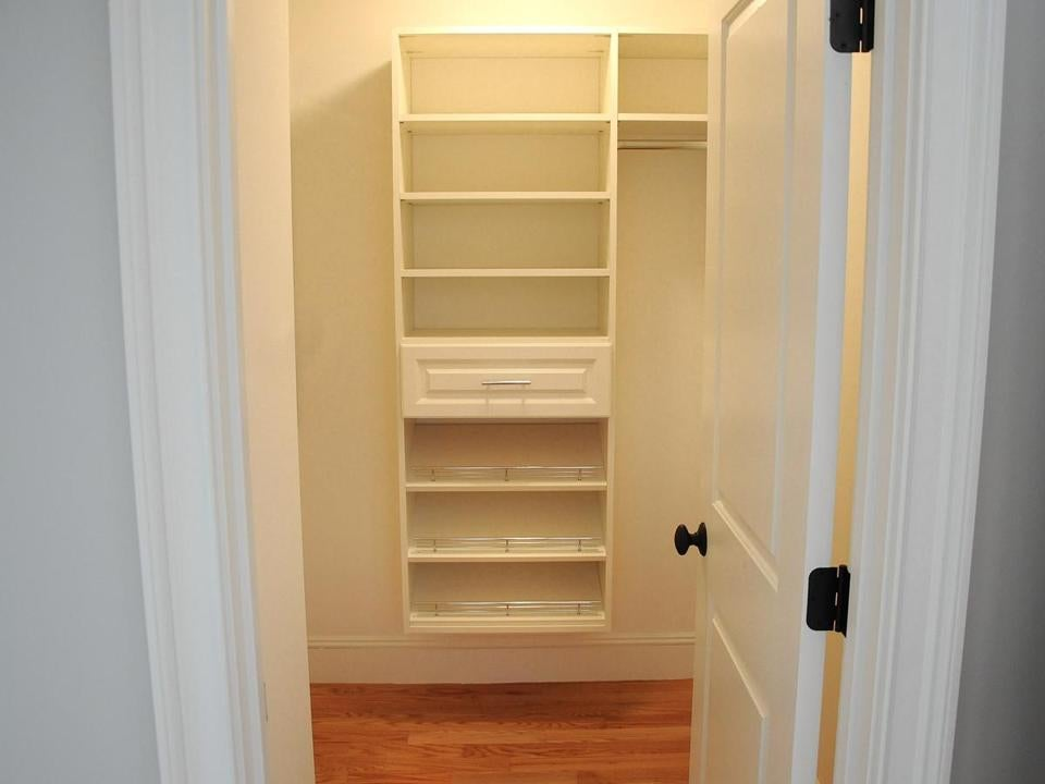 One Of The Closets Off The Master Bedroom Has Built In Shelving And A Walk