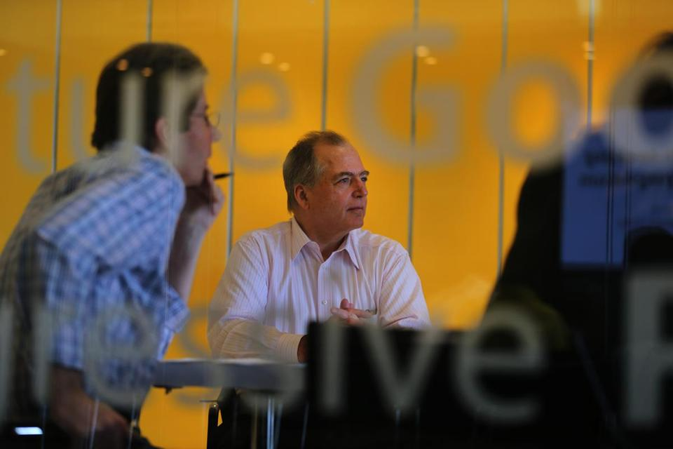 William Brah, executive director of UMass Boston's Venture Development Center, held a meeting in the MD Idea Lab.