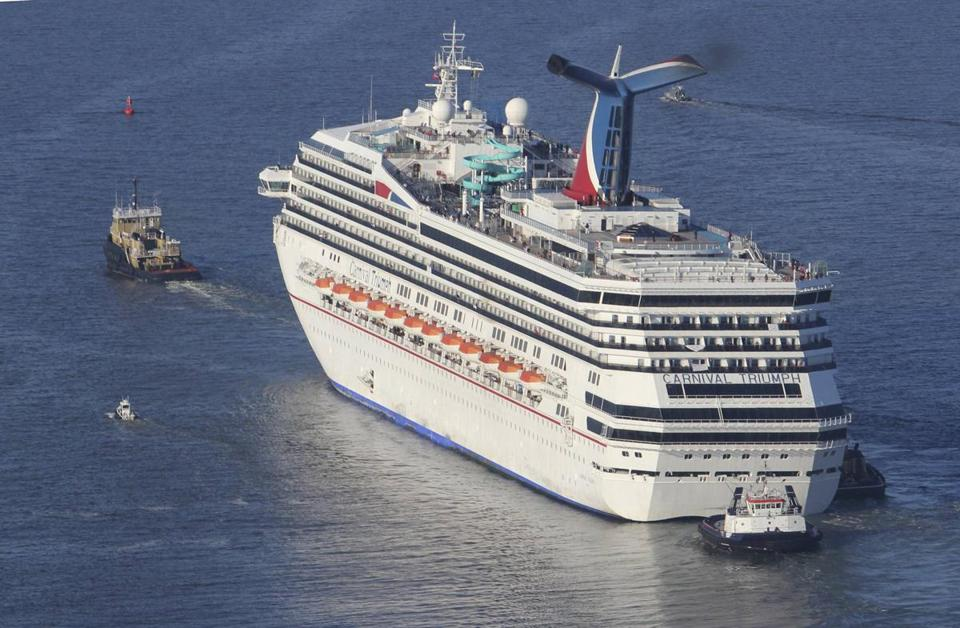 The Carnival Triumph cruise ship is towed toward the port of Mobile, Ala., last week after an engine room fire.