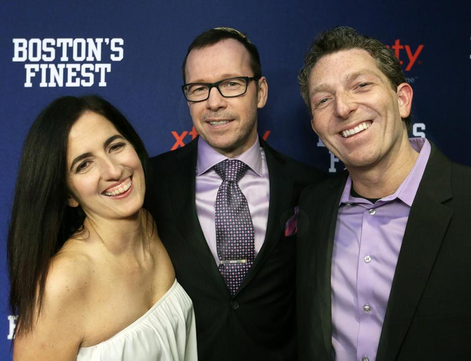 "Donnie Wahlberg (center) with Julie and Seth Jarrett at the ""Boston's Finest"" event at the Revere Hotel."