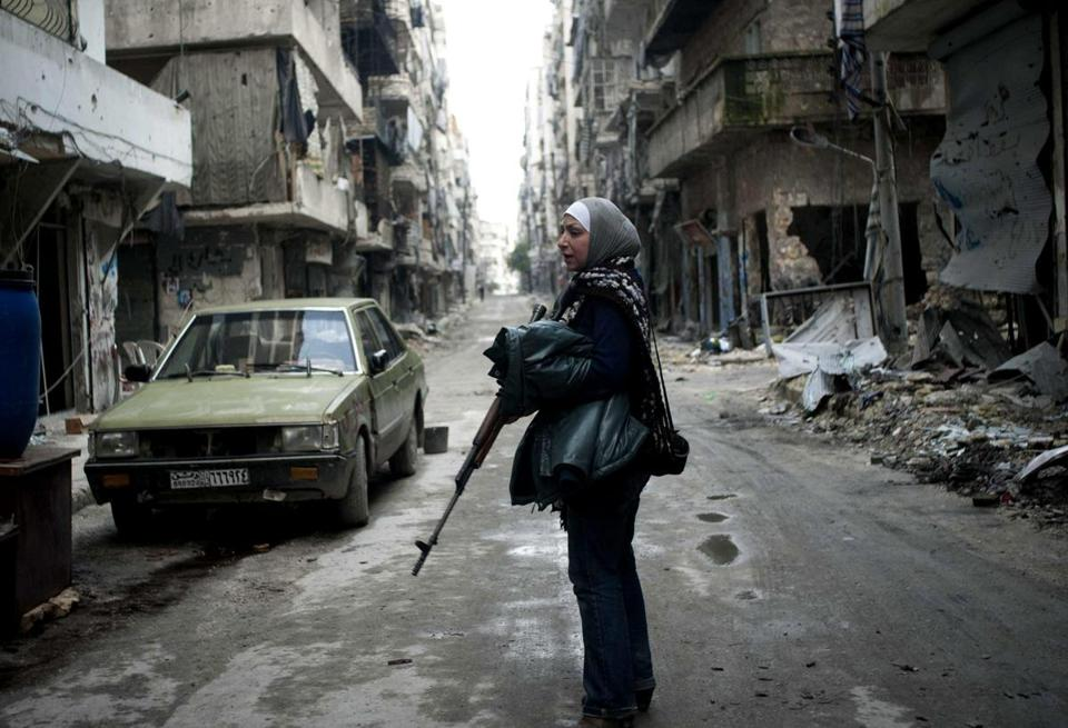 Guevara, 36, took up arms against the Syrian government forces after her two children died. Now she patrols the streets of Aleppo, as she did Tuesday.