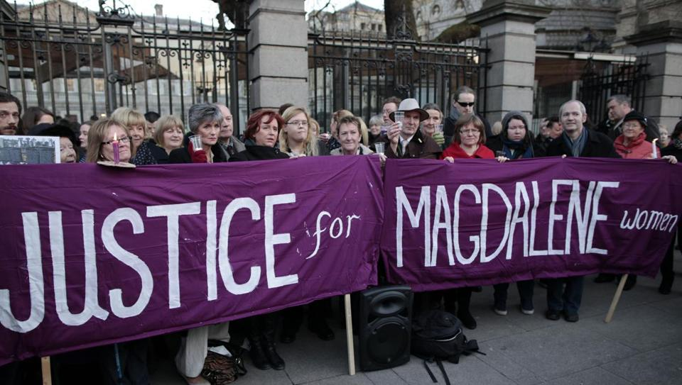 Relatives of victims of the Magdalene Laundries held a candlelit vigil outside Leinster House, the Irish Parliament building, in Dublin on Tuesday.