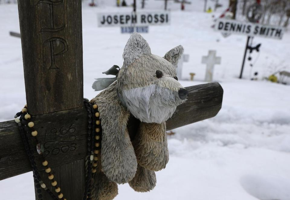 A teddy bear rests on a makeshift memorial to a victim of The Station nightclub fire on Wednesday.