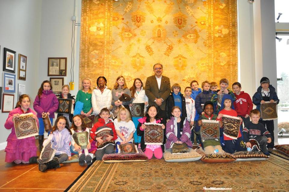 Mahmud Jafri, founder of Dover Rug & Home in Natick, recently hosted third graders from the Charles River School in Dover as part of his company's free educational outreach program on the art of rug making.