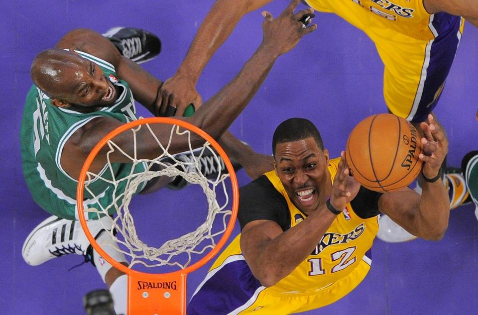 Lakers center Dwight Howard went above Kevin Garnett with a shot.