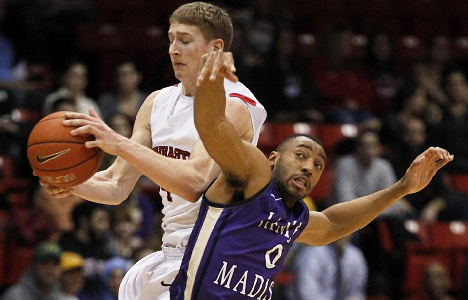 NU's David Walker, who hit the winning shot, wards off A.J. Davis to catch a pass.