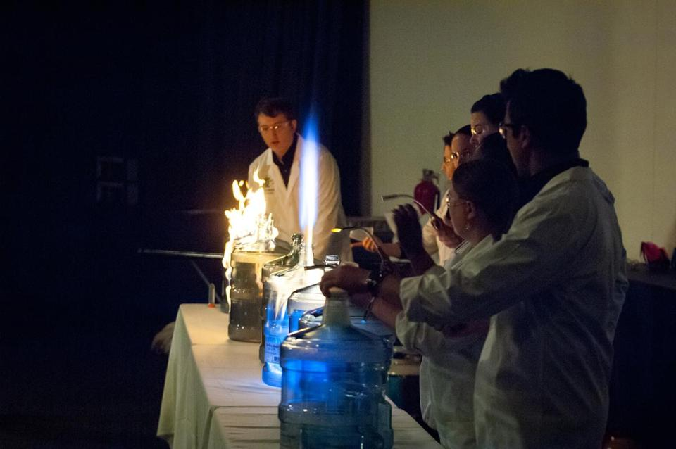 "Andrew Solomon (left) lead the ""8 Cannon Salute,"" burning isopropyl alcohol"