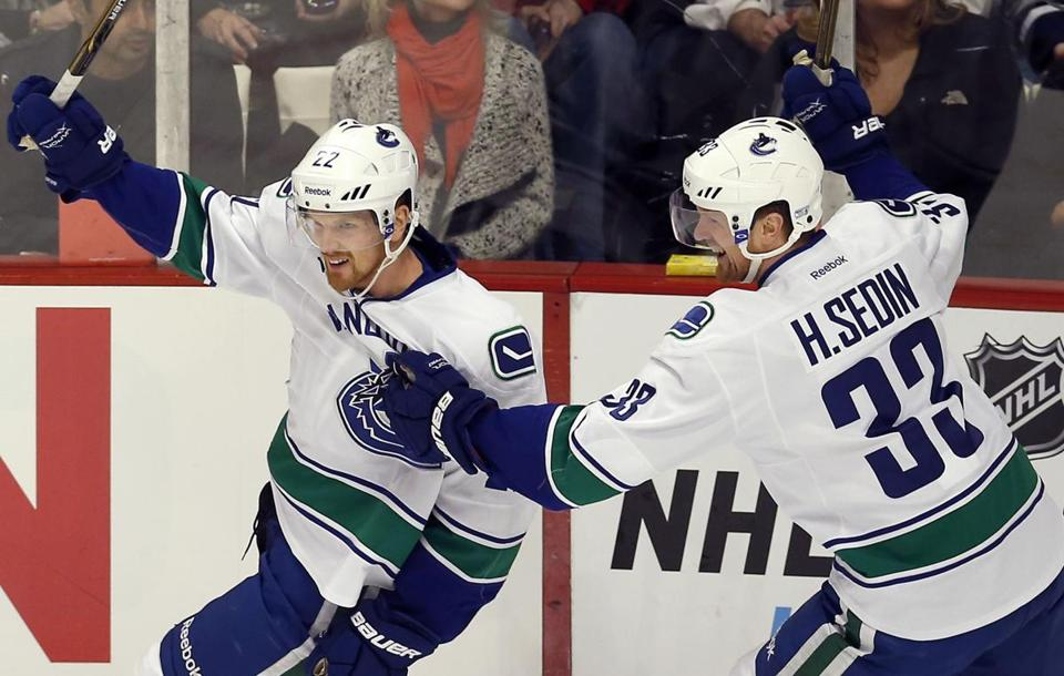 Daniel Sedin, left, trails his brother Henrik, who is the all-time leading scorer in Canucks history.