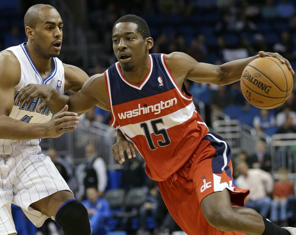 A three-player deal landed Wizards shooting guard Jordan Crawford for injured guard Leandro Barbosa and veteran center Jason Collins.