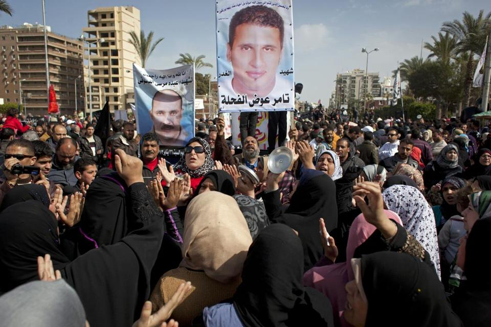 Egyptians in Port Said showed pictures of victims of violence Friday to protest President Mohammed Morsi's government.