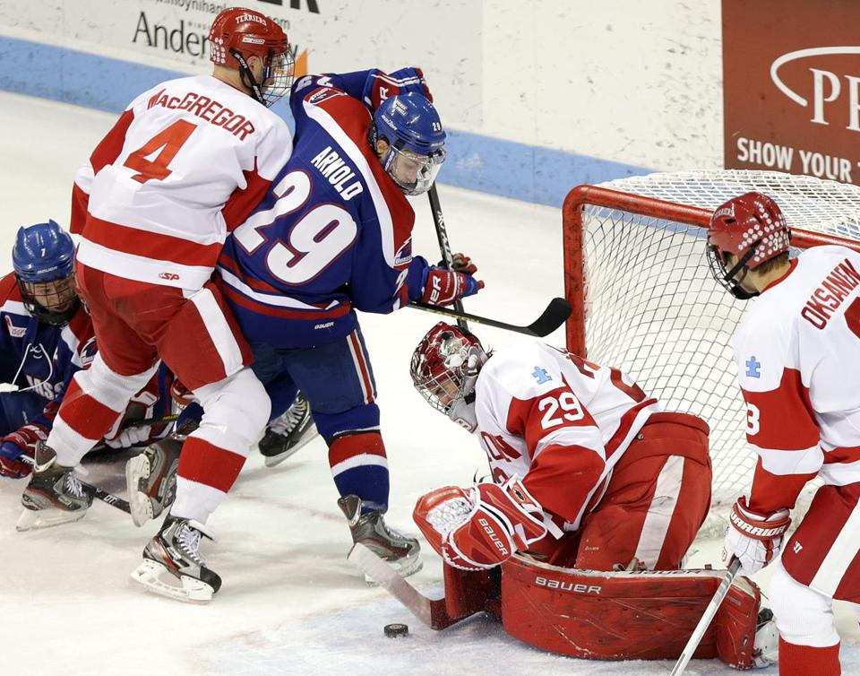 UMass-Lowell's Derek Arnold is denied by BU goalie Matt O'Connor in the second period.