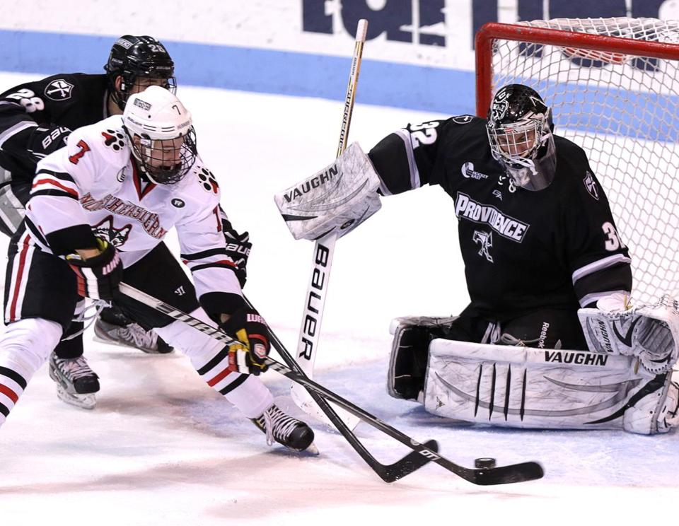 Providence goalie Jon Gillies (32 saves) uses his left pad to deny NU's Mike McMurtry.