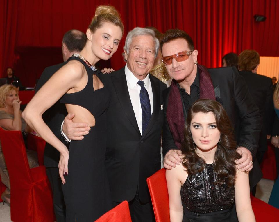 Oscar after-party attendees (from left) Ricki Lander and Robert Kraft, Bono and daughter Eve Hewson.