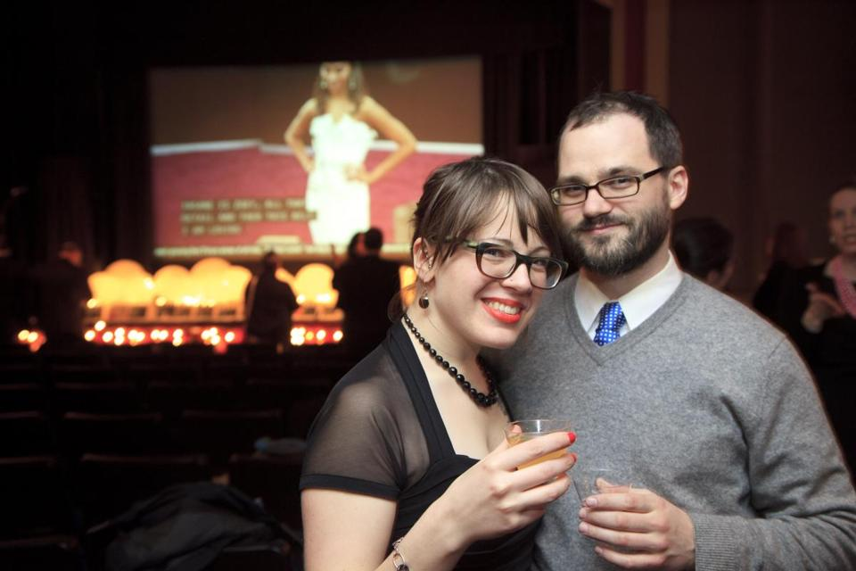 ACADEMY FANS: Caitlen Frank and Andrew McLaughlin, both of Somerville, at the annual Oscars party at the Brattle Theatre in Cambridge on February 24