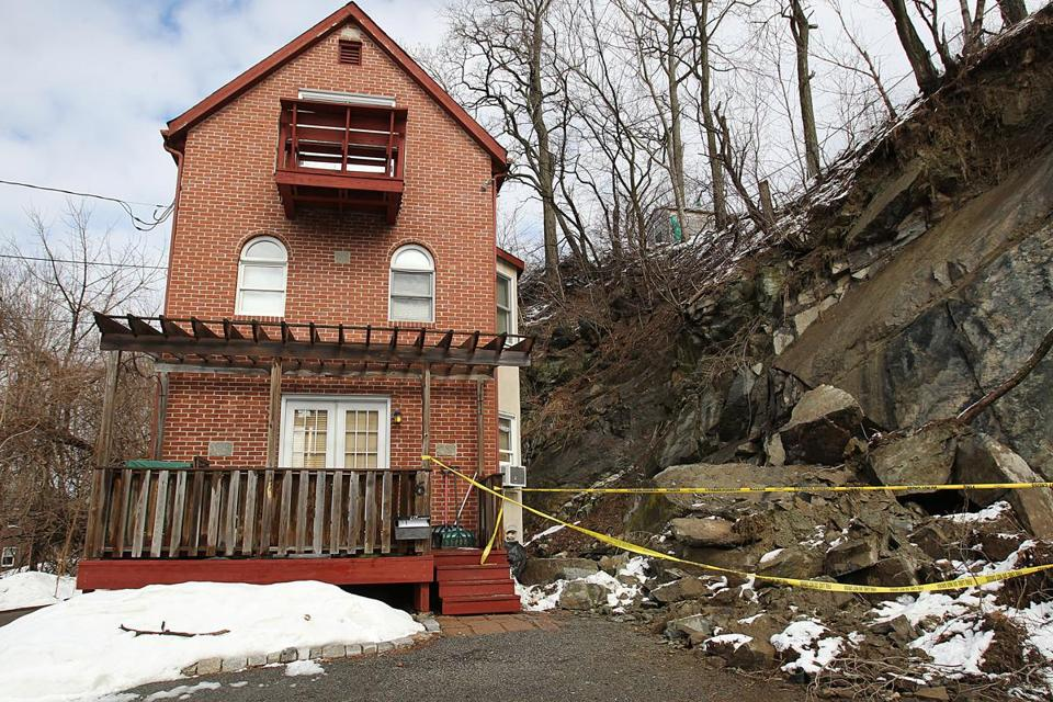 A section of the cliff slid down next to the house, according to the Boston Fire Department. No damage and no injuries were reported at the home, located on on a dead-end street.
