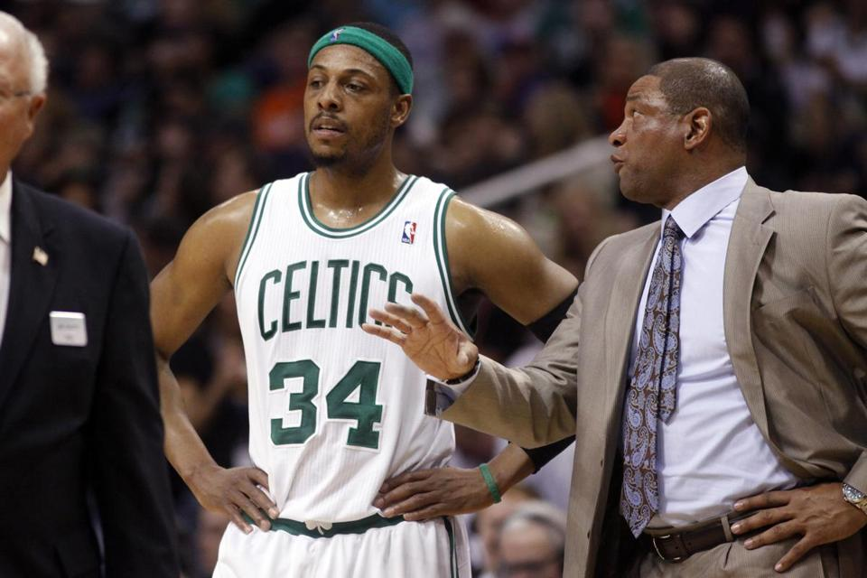 Paul Pierce confered with coach Doc Rivers.