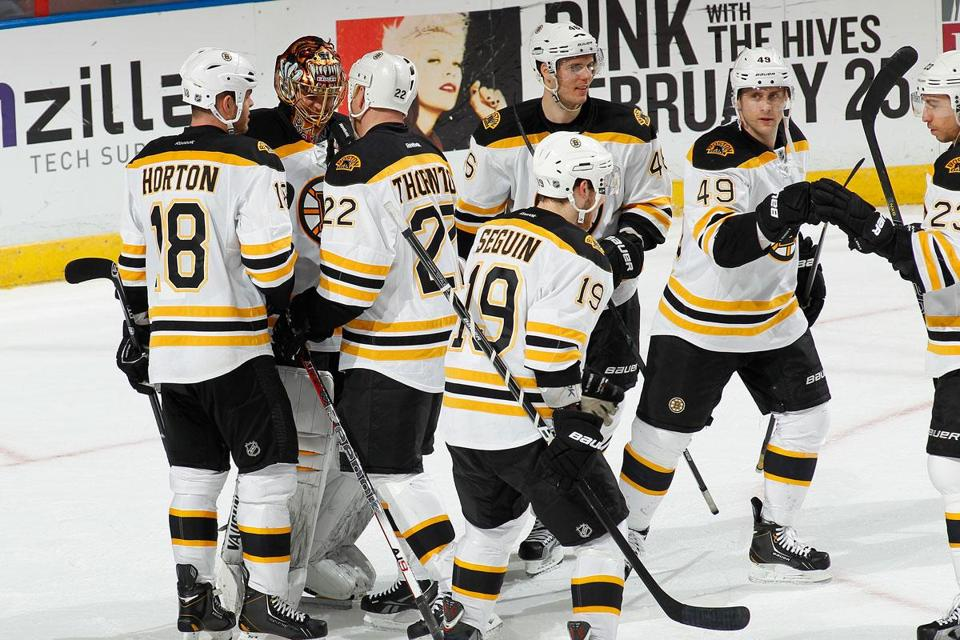 The Bruins congratulated Tuukka Rask after the team's win over the Panthers.