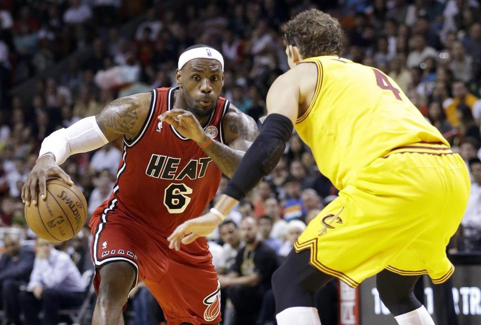 LeBron James drives to the basket against Cavaliers forward Luke Walton on his way on to a game-high 28 points.