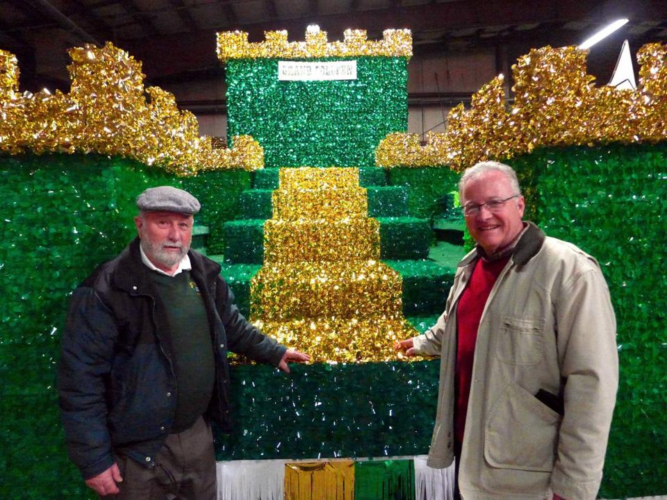 Richard Dupuis, left, and Ray Feyre with the Holyoke St. Patrick's Day parade colleen float, one of about 40 entered.