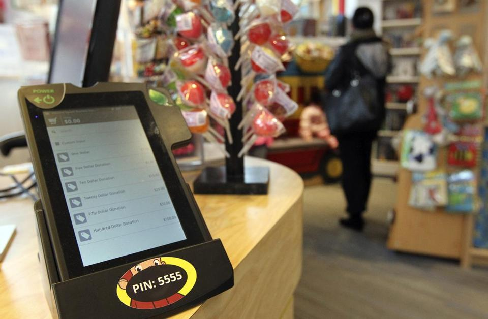 The World's Only Curious George Store is one of the first in Harvard Square to install tablets that allow donations to the homeless.