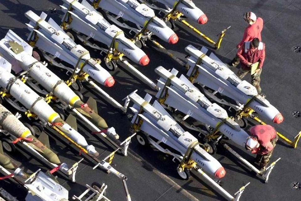 Raytheon Co., which makes the missiles shown aboard the USS Enterprise in 2010, recently reduced its worldwide workforce by 3,000 people, to 68,000.
