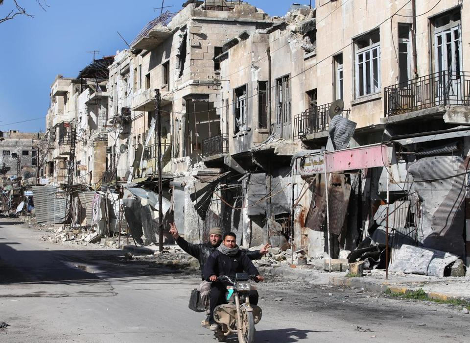 A street in the Syrian town of Maarat al-Nuaman in Idlib Province was among those heavily damaged by government shelling on Tuesday.